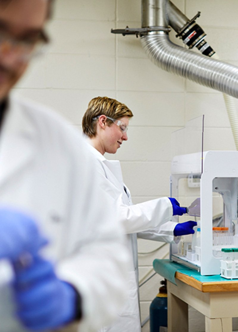 Two lab workers working
