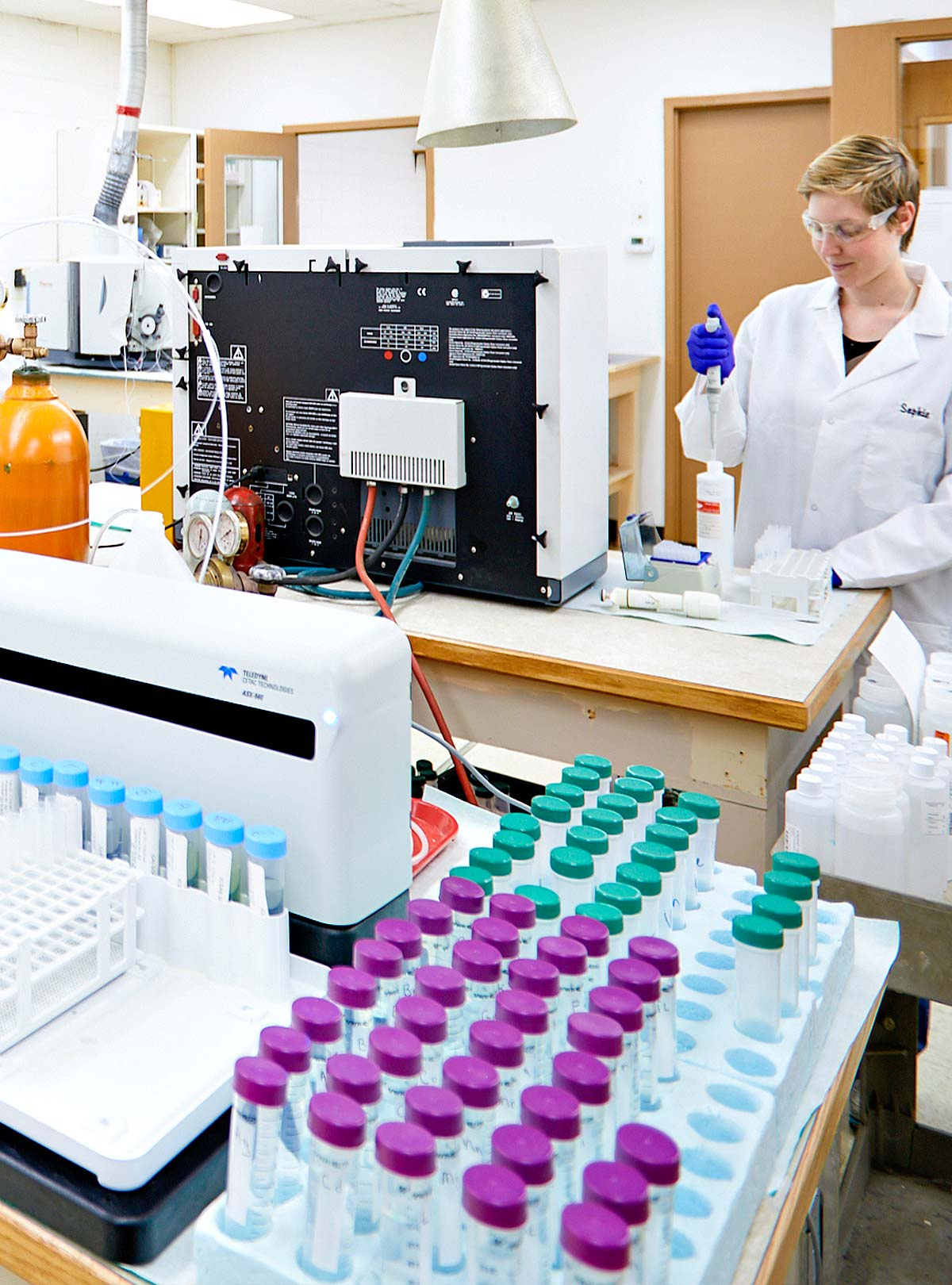 Workers at SVL prepare samples in lab