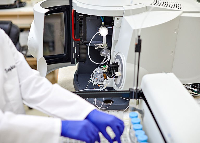 Lab worker working samples
