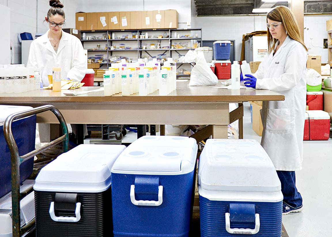Lab workers filling samples